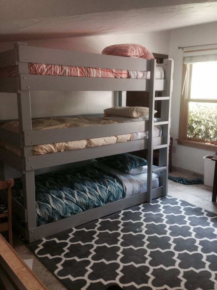 Three in one room? No problem! Zach and I built this triple bunk bed, sanded it, and painted it gray. This will work while we look for a bigger house!