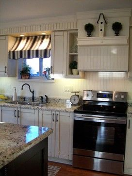 How about with black lower cabinets and lighter upper cabinets?