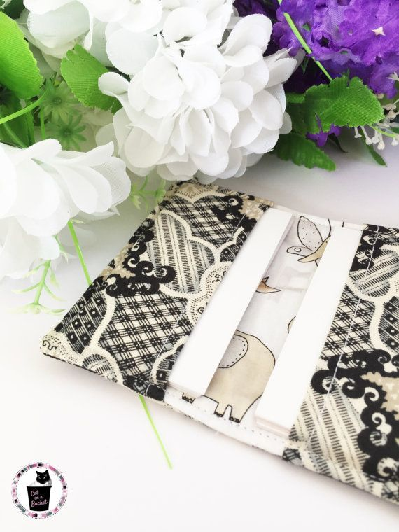 A lovely vintage look on the outside and the lining adds a bit of animal cuteness.  Perfect for holding your cards.