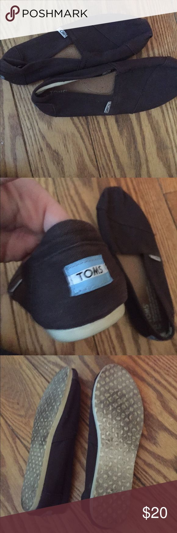 lightly worn chocolate brown toms cute brown and white flats with a blue symbol. lightly worn. no wear except discoloration of bottom. sold for a cool great cause TOMS Shoes Flats & Loafers