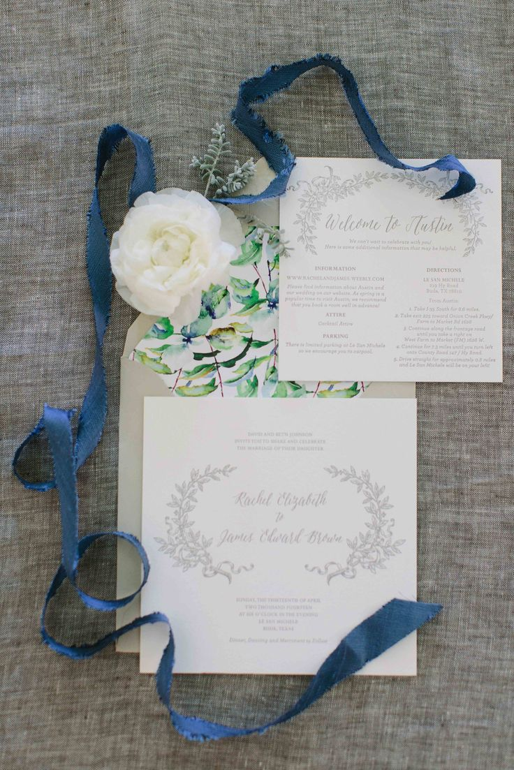 Light white and grey elegant wedding invitation suite with botanical envelope liner, designed by The Nouveau Romantics, photography by Heather Hawkins Photography || Style Me Pretty