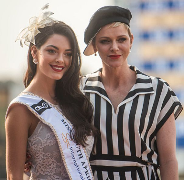 The new Miss SA, Demi-Leigh Nel-Pieters poses with Princess Charlene of Monaco (R) during the Princess Charlene Ladies Day at Turfontein Race course on April 23, 2017 in Johannesburg, South Africa.