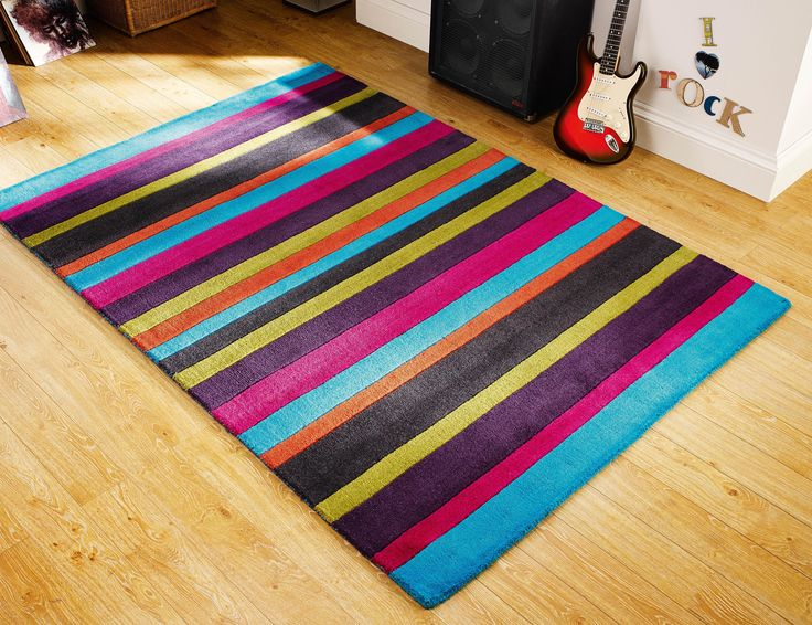 Bold & Striking Multicoloured Rug. Give your room a colourful look and feel. #woolrugs #largerugs #modernrugs #luxuryrugs #multicolouredrugs