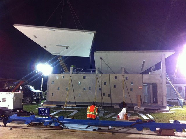 Craning a roof panel into place by ENJOY House - Team NJ, Solar Decathlon 2011, via Flickr