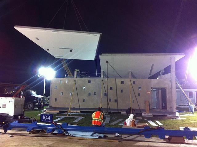 Craning a roof panel into place by ENJOY House - Team NJ, Solar Decathlon 2011, via Flickr