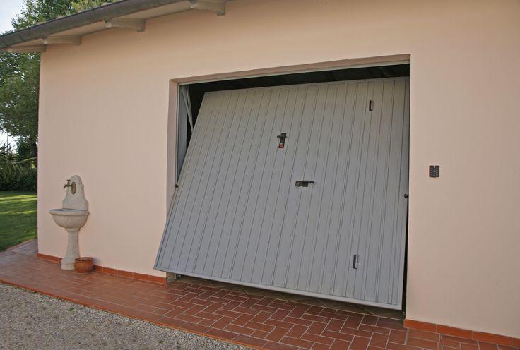 Porta basculante per garage in acciaio modello iron for 2 piedi quadrati per garage