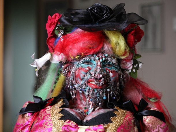 This lady is the most pierced woman in the world. Is it me, or do the dangly piercings look beardlike?