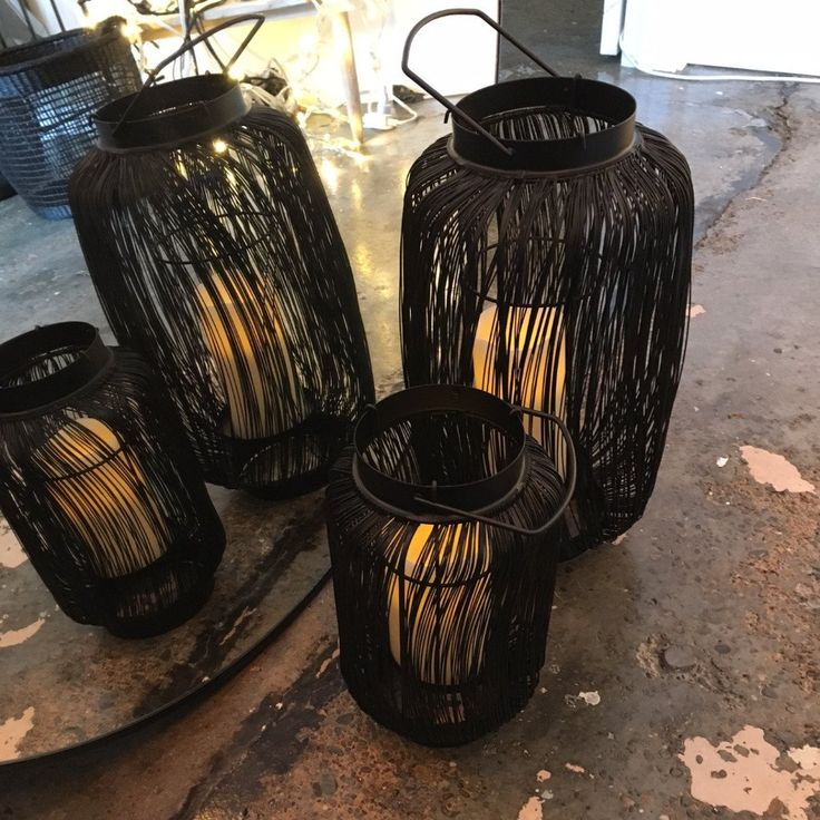 Striking black wire candle lantern. Great against a white wall or out on the deck.
