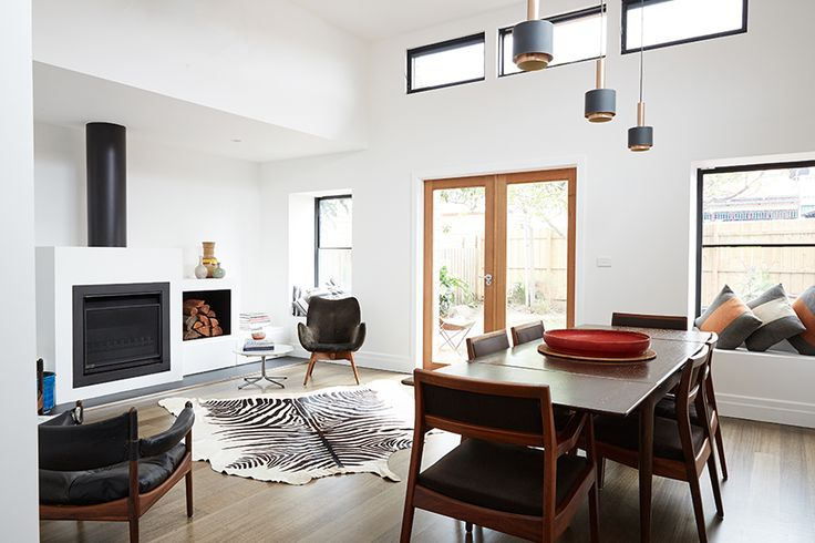An open fire, window seats and doors to the garden matched with high clerestory windows create an inviting space for dining/sitting/living room