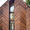 Malboeuf Bowie Architecture's Seattle's Palatine Passive features a charred herringbone façade and consumes 90% less energy than a conventional house.