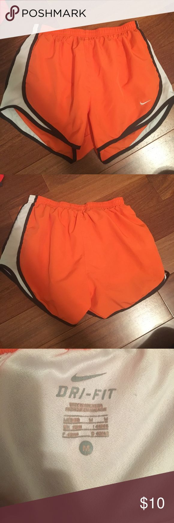 Orange nike running shorts for women size M No stains great condition super comfortable and cute color. Also on the shorter side so it's cute while still sporty. But not too short! And i'm 5'10 so it's all good. Nike Shorts