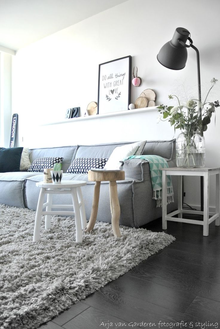 Cosy light grey living, love the geometric Hema mint plaid