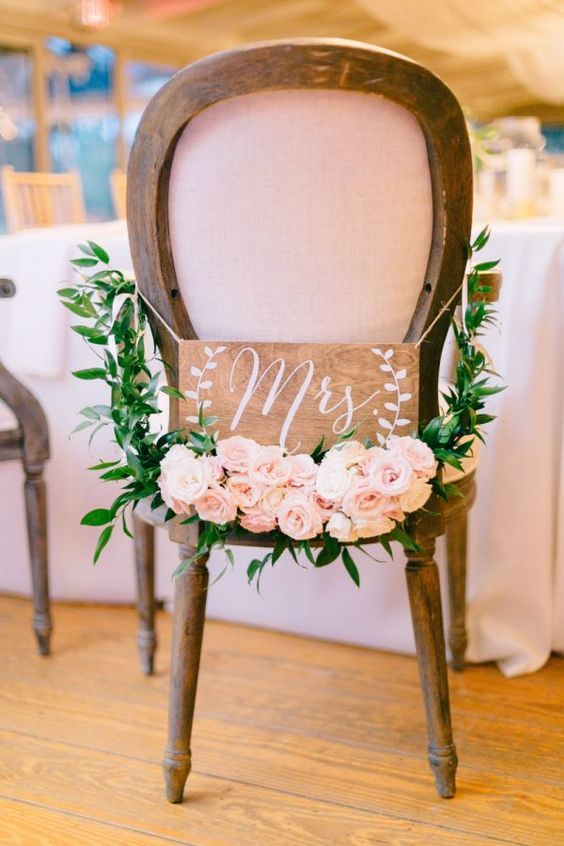 Swag up your sweetheart chairs with this rustically elegant pair of wooden signs. Prefer different wording? These handmade pieces can customized to your liking. | Photo by Catherine Ann Photography