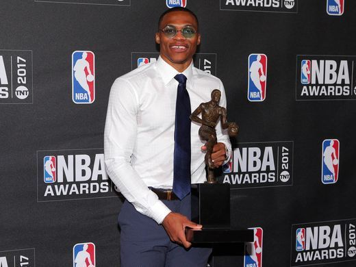 Russell Westbrook poses for photos with his 2017 NBA
