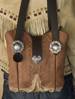 Turn your old cowboy boots into a Tote Bag or Purse, with a little help from the folks at West Texas Totes. Not cheap, but how fabulous is this? You can buy bags made from new boots, or work with these guys on prices and materials from your old boots. LOVE THIS. I have some cool old boots that I just can't bear to part with...