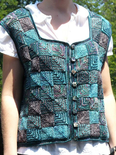 This semi-fitted vest is composed of many squares knit in garter stitch with random color distribution. The squares can be joined together either horizontally or vertically. The pattern calls for two solid colors, with different variegated colors, used interchangeably. There will probably be leftover yarn.