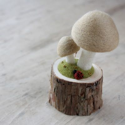Felted mushrooms - So cute! If the mushrooms were painted red with white dots it would be oh so Swedish!