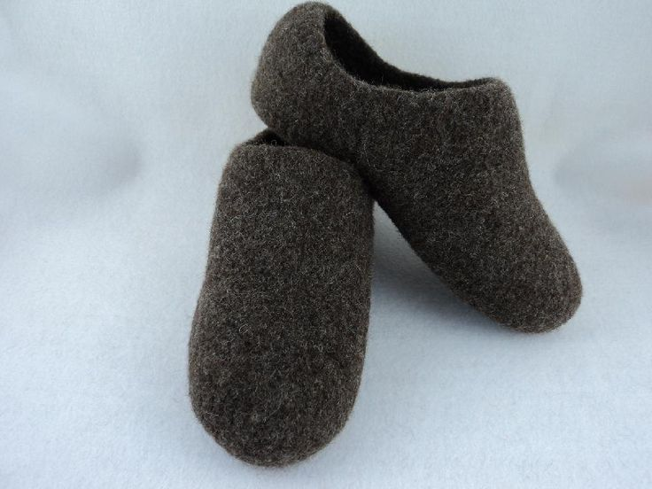 """Size 8 - 14! These slippers are knit in one piece - No Sewing Required. They are designed for maximum coverage. New improved pattern - better fit - use less yarn.The slippers are knitted in the round as well as straight knitting and uses 100% wool worsted weight yarn, basic knit stitches, 29"""" circular needles or double pointed size US 11. Skill level, easy to moderate, short row knitting involved. Machine washing for felting technique.Pattern includes a materials list, detailed instructions…"""