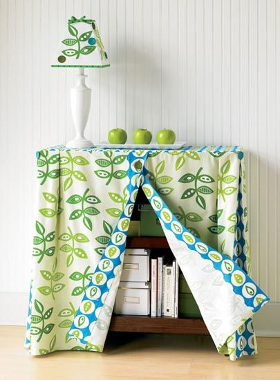 how to make a fabric cover that transforms a humble bookcase into a pretty skirted table. >  http://www.creativehomeartsclub.com/projects/articletype/articleview/articleid/920/categoryid/825/shelf-cover-and-embellished-lampshade