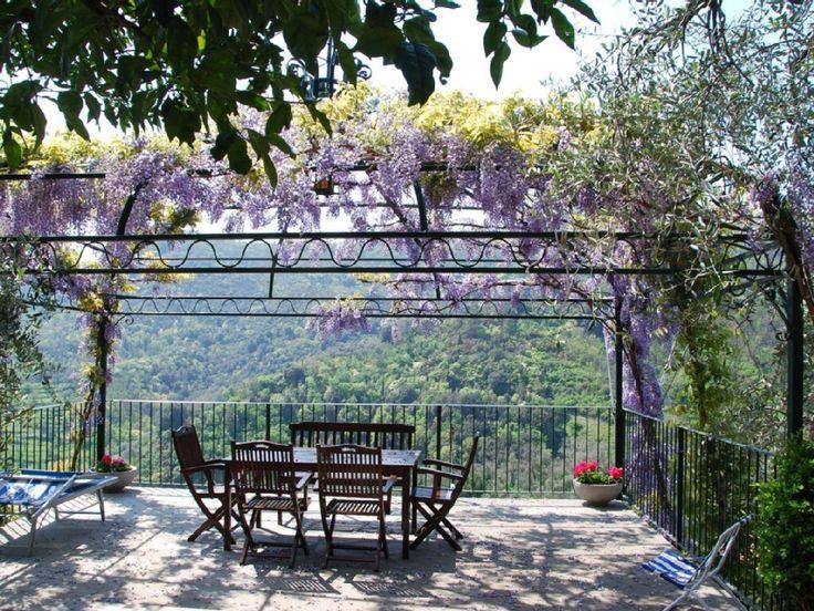 Leivi, Portofino, Cinque Terre Rentals. Under the violet flowers.