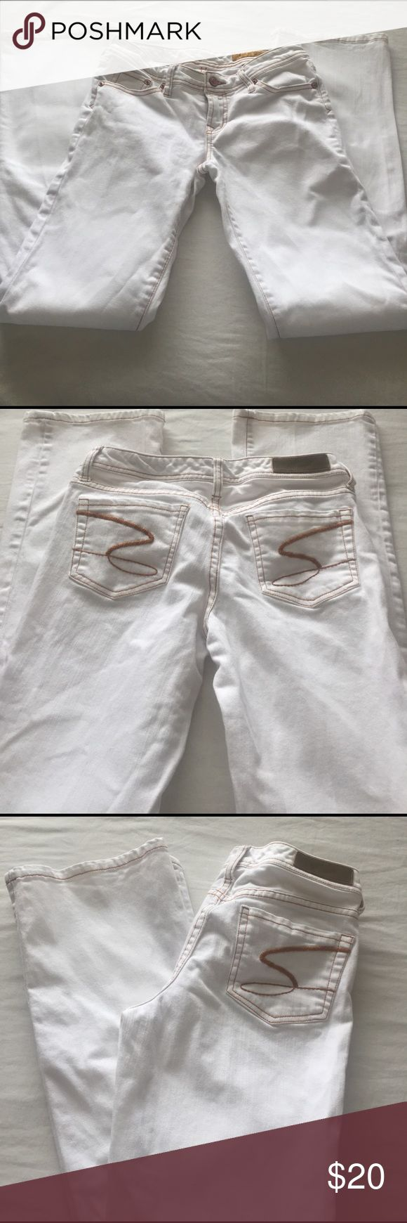 SALE! Seven7 Classic Flare Leg White Jeans White flare leg jeans with tan stitching, inseam 32. Has 3 tiny light dot stains above left knee the size of a pin head, fixable with a bleach pen (show in last photo). Overall these jeans are in good condition. Seven7 Jeans Flare & Wide Leg