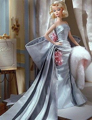 DELPHINE BARBIE  Barbie Fashion Model Collection, Limited Edition, 2000.    Delphine™ Barbie®doll embodies the ultimate expression of style and elegance in a strapless evening gown in pale turquoise taffeta with a dramatic bow, draped train, and delicate pink flower accents. Her white faux fur stole lined in pink satin gives her stunning ensemble the final glamorous touch.    NOTE - This is an older doll. The box may have scratches or dings. The doll is MINT. $195.00