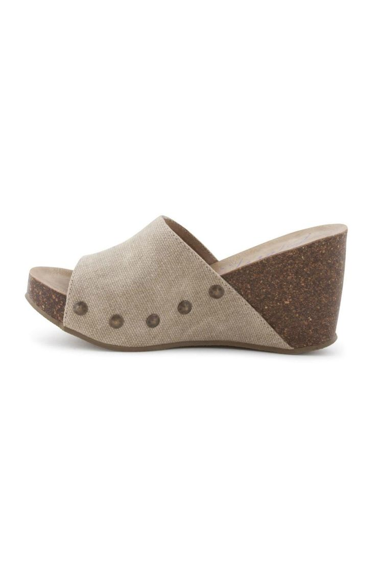 Need a hot wedge sandal this spring? You know we've got you! Wear the most style with Blowfish Shoes Host. This slide-on wedge features a faux cork sole and a canvas upper. These can easily be paired with a spring sun-dress.  Host Sand Wedge by Blowfish. Shoes - Wedges Alabama
