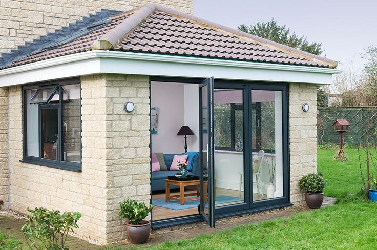 Side view with open door of an Everest Tiled Roof Extension