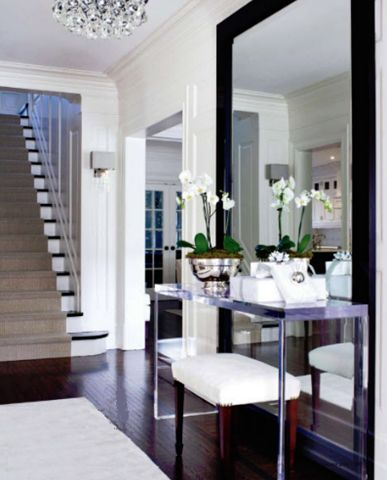 Modern Entryway. Love the Large Framed Mirror, console table, bench, accessories. Beautifully designed!