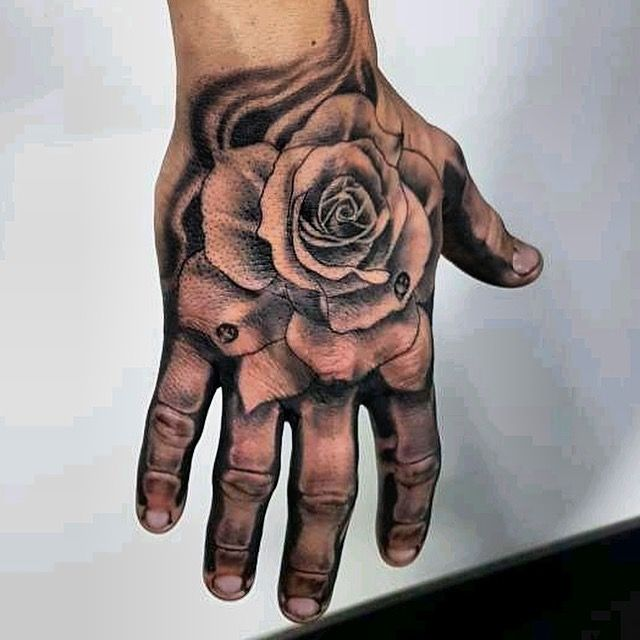 Hand Tattoo Black Ink With Rose Done In Tattoostudio Tat2holics Den Haag Rose And Bones We Dont Just Do Tattoo S We Deliver You An Experience Our Tattoo Are