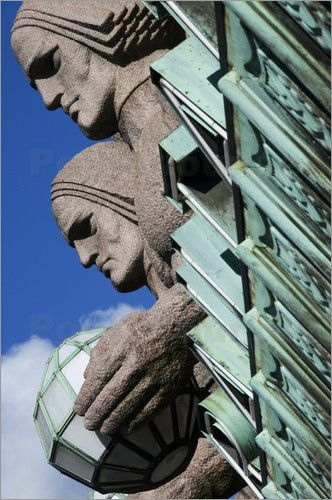 Krzysztof Dydynski - Granite giants carrying round lamps guarding main entrance…