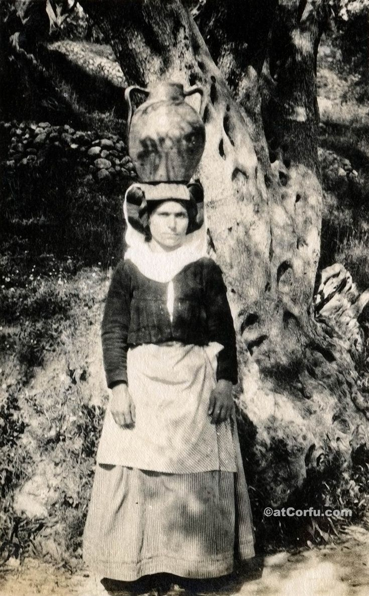 Corfu old photos-woman carry water 1930. Corfu of 1900 through unique photos. https://atcorfu.com/corfu-old-photos/