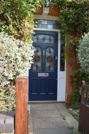 Navy blue victorian stained glass door