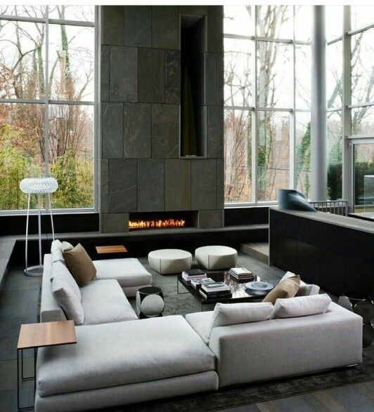 Lounge. Corner seating. Minimal. Cozy. Large tiled fire place.