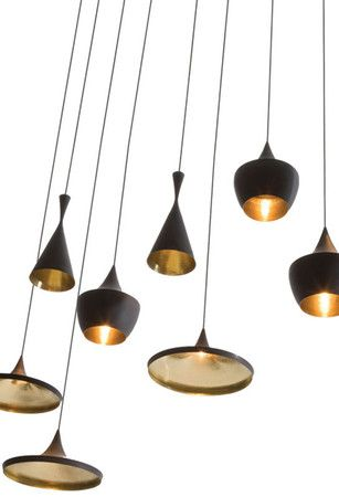 A row of these hanging from the center of the dining room roof?  In white/silver