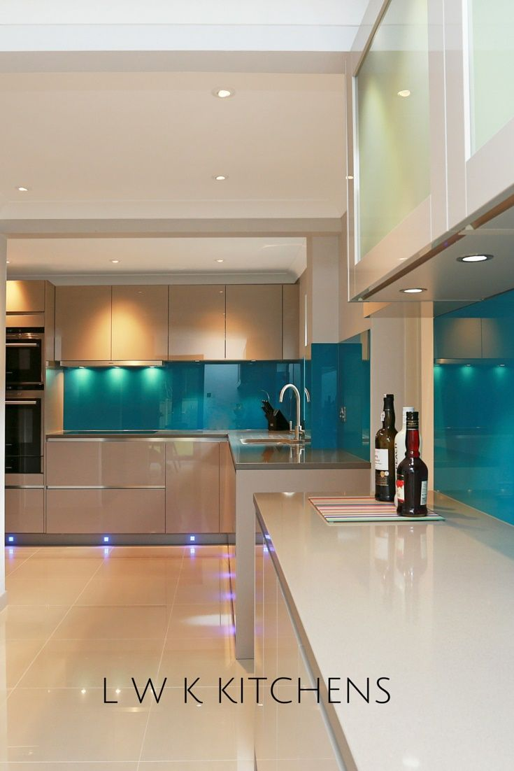 Cashmere high gloss kitchen with a blue splashback in Kent. #kitchen #highgloss #glossy