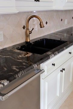 Titanium/ Cosmic Gold Schist counters. Black with silver and copper, white cabinets.  Visit globalgranite.com for your natural stone needs.