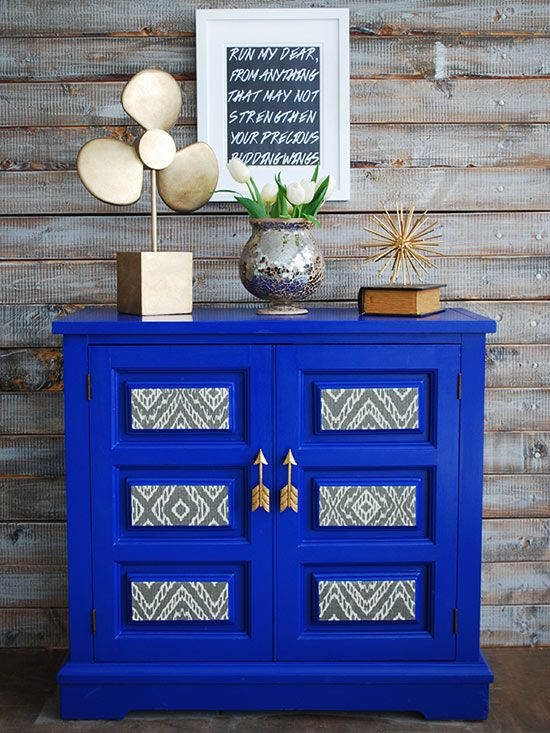 Bre of Brepurposed pulled out all the stops when updating this secondhand storage piece, and we can't decide on its most striking feature. Is it the cobalt blue paint job? The surprising fabric accents? Or the metallic arrow hardware? Somehow, the all three bold choices work on this statement-making cabinet.