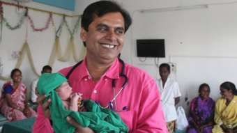 The doc who delivers girls for free.  Dr Ganesh Rakh with a baby girl