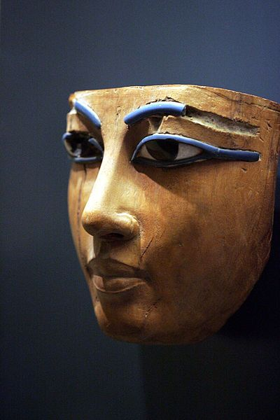 Ancient Egyptian funerary mask, encrusted wood, about 1400-1300 BC, end of 18th dynasty.  by Rama