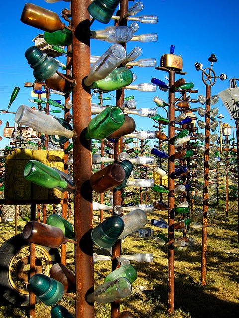 I love the funky things at the tops like the toaster.  Elmer's Bottle Tree Ranch 20  Route 66, Bryman, California