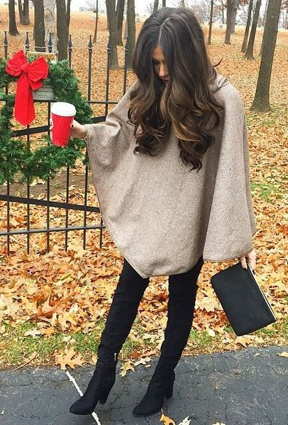 Love her hair! And Boots, and poncho....love love love!