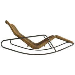 Rare Dirk van Sliedrecht rattan rocking chair 1960's   From a unique collection of antique and modern chaises longues at https://www.1stdibs.com/furniture/seating/chaises-longues/