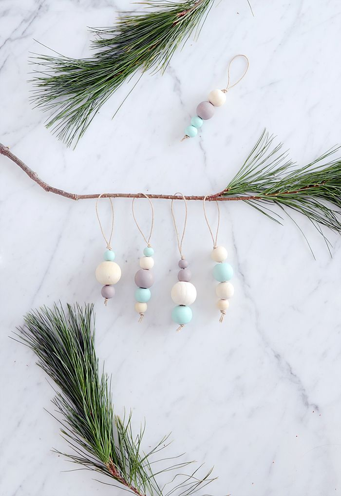 Today is my first Christmas DIY that I'm sharing here this year. It's not technically the first project I've done, but the first one to get some photos taken. These wood bead ornaments must be the e