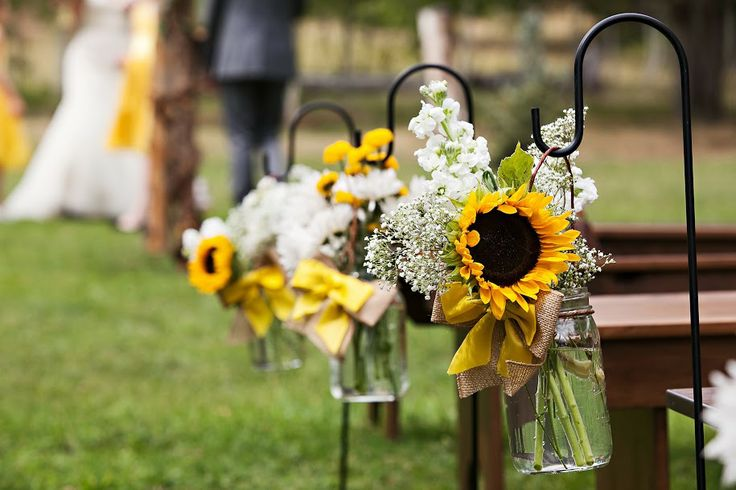 Our wedding.  Mason jar with sunflower, baby's breath, and stock.  (photo credit opiefoto.com)