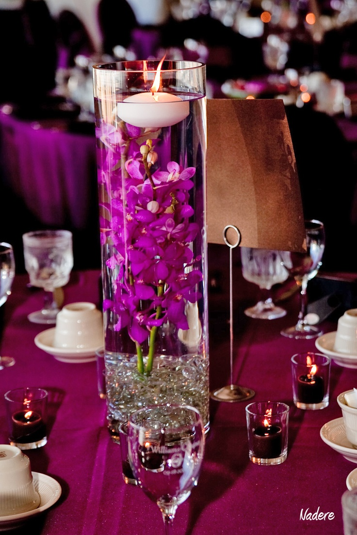Candle centerpiece images wedding reception candle - Submerged Purple Orchid And Floating Candle Centerpiece