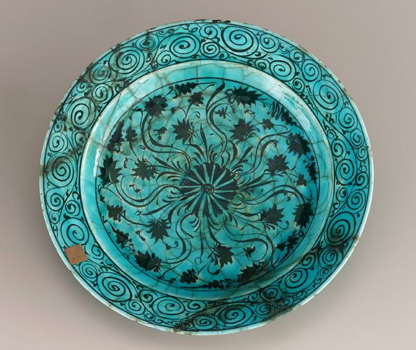 Dish  17th century  Stone-paste with black decoration under turquoise glaze  H: 6.0 W: 34.7 D: 34.7 cm   Iran