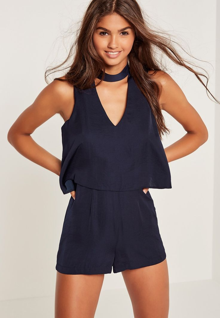 We're getting all choked up in this playsuit - featuring a dark navy hue, double layer style and a silky finish.