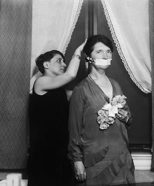Margaret Sanger has her mouth covered in protest of not being allowed to talk about birth control in Boston. 1929