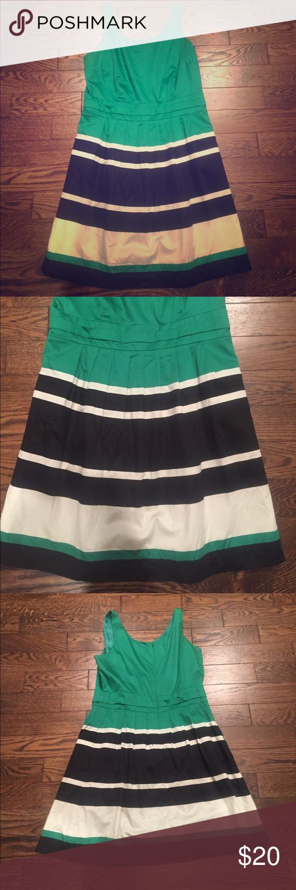 The Limited Dress Size 14 Super flattering and bright The Limited dress in size 14.  It has only been worn a few times and in great condition! It is green with black and white stripes.  It is a zipper back with a flowy skirt. It is 98% Cotton and 2% Spandex! I am cleaning out my closet before a move so feel free to make an offer! The Limited Dresses
